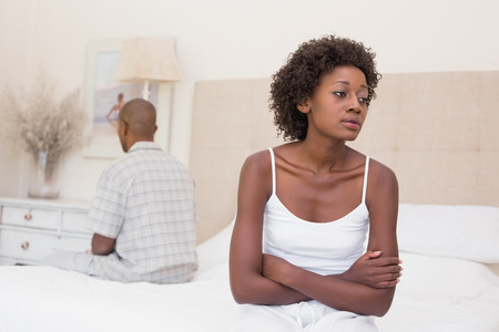 african american couple: Unhappy couple not speaking to each other on bed at home in the bedroom Stock Photo