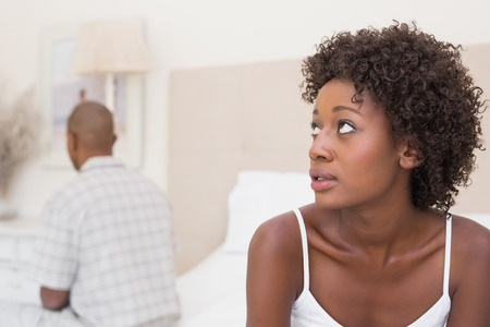 couple talking: Unhappy couple not speaking to each other on bed at home in the bedroom Stock Photo