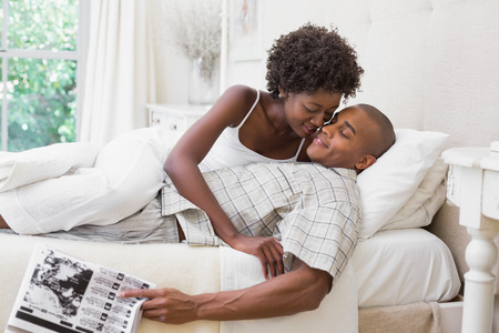 Intimate couple messing about in the morning on bed at home in the bedroom photo