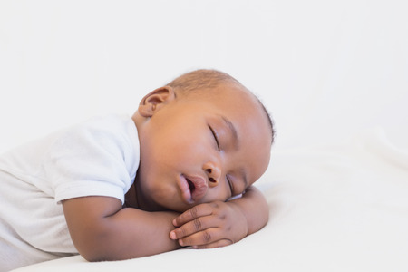 peacefully: Adorable baby boy sleeping peacefully at home in the living room Stock Photo