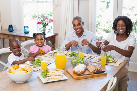 family meal: Happy family enjoying a healthy meal together at home in the kitchen