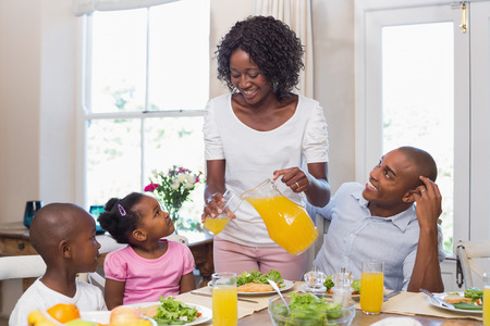 plate of food: Happy family enjoying a healthy meal together at home in the kitchen