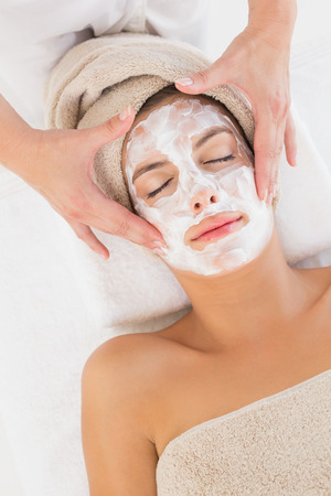 Close-up of an attractive young woman receiving treatment at spa center Stock Photo