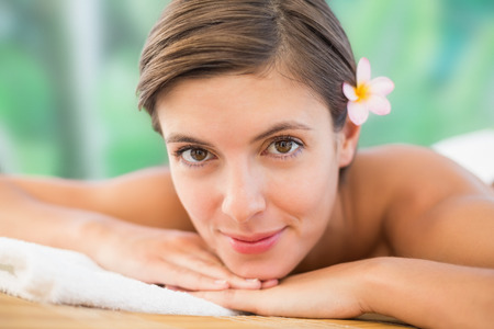 Close up of a beautiful young woman on massage table at health farm photo