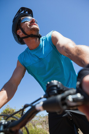 adventuring: Fit cyclist out in the countryside on a sunny day