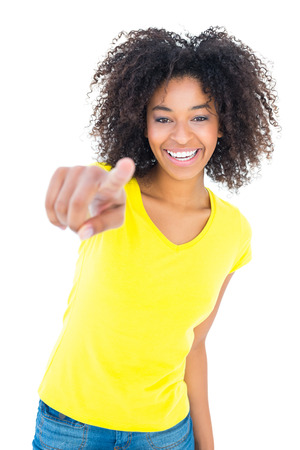 hot pants: Pretty girl in yellow tshirt and denim hot pants smiling at camera on white background Stock Photo