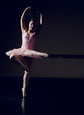 en pointe: Beautiful ballerina dancing en pointe in the dance studio Stock Photo