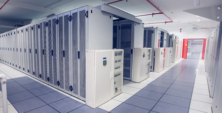 data center: Empty hallway of server towers in large data center