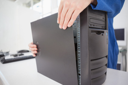 shutting: Computer engineer shutting up fixed console in his office