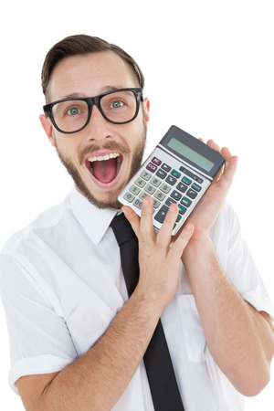 Nerdy excited businessman showing calculator on white background photo