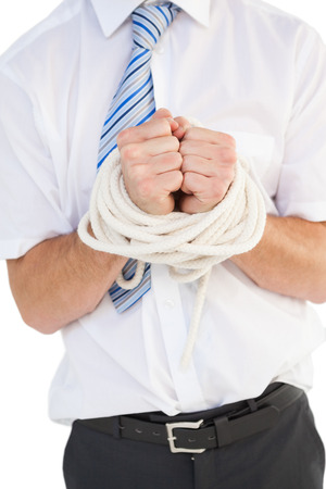 Businessman tied up in rope on white background photo