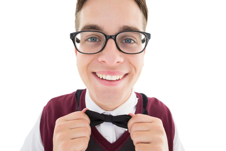Nerdy hipster fixing his bow tie on white background Stock Photo