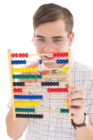 mathematician: Nerdy hipster adding on abacus on white background