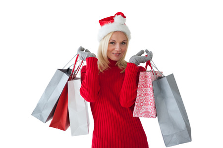 Festive blonde holding shopping bags on white background photo