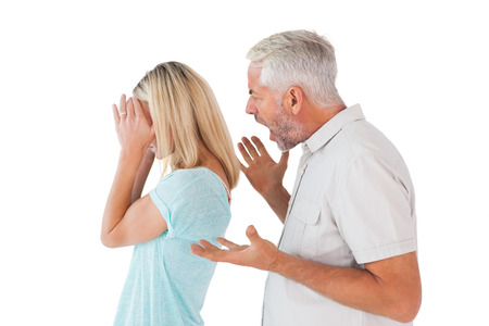 cowering: Angry man shouting at his wife on white background