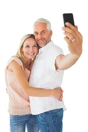 taking a wife: Happy couple posing for a selfie on white background