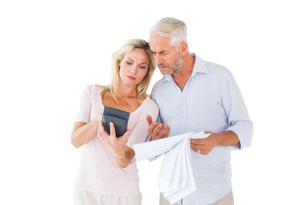 figuring: Anxious couple working out their bills on white background