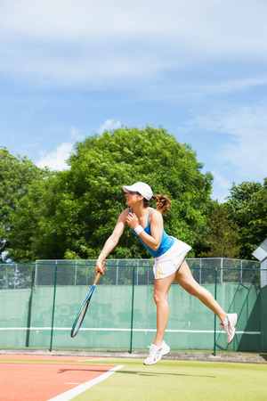 tennis skirt: Tennis player about to serve on a sunny day Stock Photo