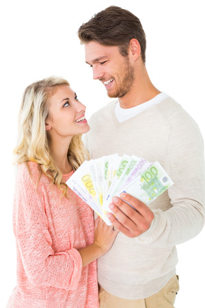 Attractive couple flashing their cash on white background photo