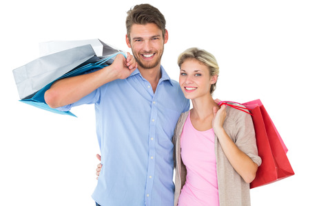 Attractive young couple holding shopping bags on white background photo