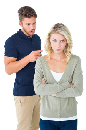 outraged: Young couple having an argument on white background