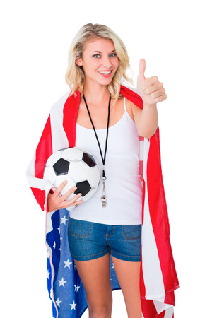 Pretty blonde football fan wearing usa flag showing thumbs up on white background photo