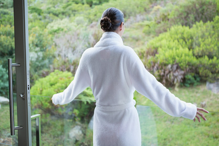 Rear view of a young woman wearing a bathrobe photo