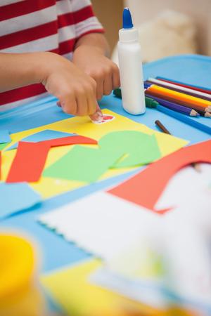 Cute little boy making art in classroom at the nursery school