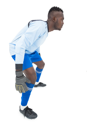 goal keeper: Full length side view of a concentrated goal keeper over white background Stock Photo