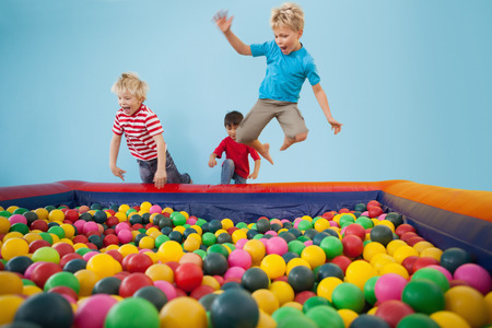 pool ball: Happy children playing in ball pool at a party Stock Photo