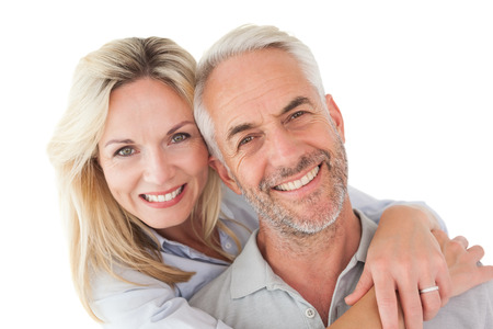 Close up portrait of happy mature couple over white background Stockfoto