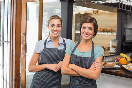 Pretty waitresses smiling at camera at the coffee shop photo