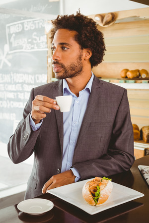 lunch hour: Businessman enjoying his lunch hour at the coffee shop Stock Photo