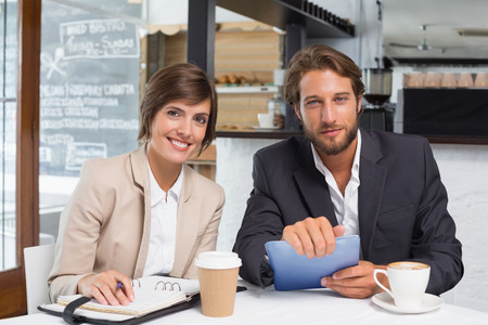Business colleagues working on their break at the coffee shop photo