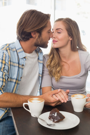 coffee shop: Happy couple enjoying a coffee at the coffee shop Stock Photo