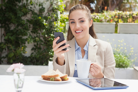 Beautiful businesswoman on her lunch outside at the coffee shop photo