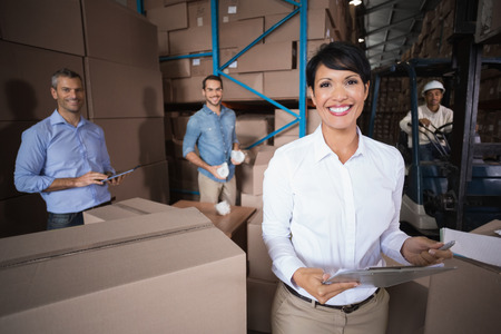 Warehouse workers preparing a shipment in a large warehouse photo
