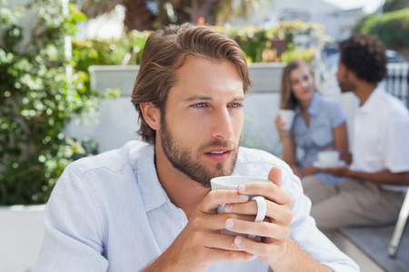 18 to 30s: Thoughtful man having a coffee outside at the coffee shop Stock Photo