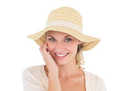 sun hat: Close up portrait of attractive young woman wearing sun hat over white background