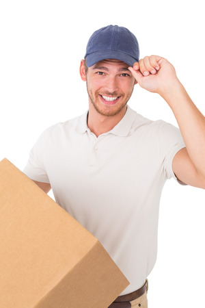 above 21: Portrait of smiling young delivery man standing over white background Stock Photo