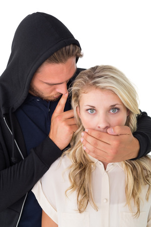 Close up of theft covering young womans mouth over white background photo