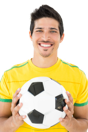 football world cup: Portrait of a smiling handsome football player over white background