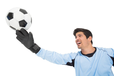 goal keeper: View of goal keeper in action over white background