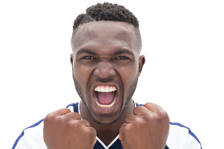 outraged: Close up of a football player shouting over white background Stock Photo
