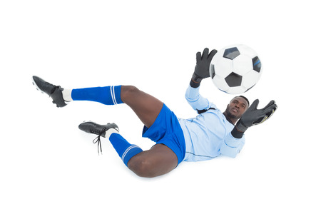 goal keeper: Full length of goal keeper in action over white background Stock Photo