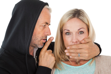 Close up of theft covering womans mouth over white background photo