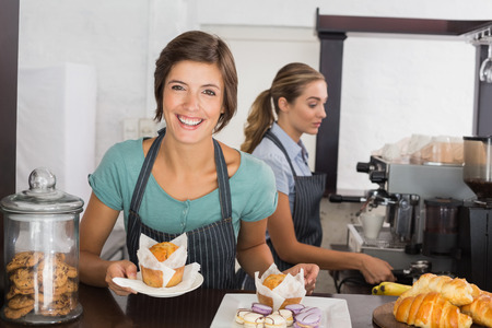cafe shop: Pretty waitresses working with a smile at the coffee shop