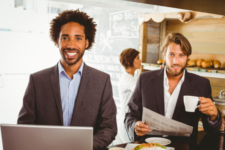 lunch hour: Businessmen enjoying their lunch hour at the coffee shop