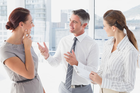18 to 30s: Businessman discussing work with co-workers in the office Stock Photo