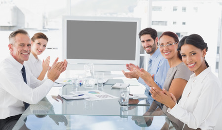 Business colleagues giving applause in a meeting Imagens